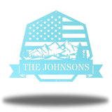 "Light blue heptagonal-shaped US flag wall decor featuring outdoor scenery and the texts ""THE JOHNSONS"""