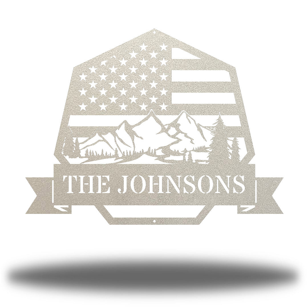"Silver heptagonal-shaped US flag wall decor featuring outdoor scenery and the texts ""THE JOHNSONS"""