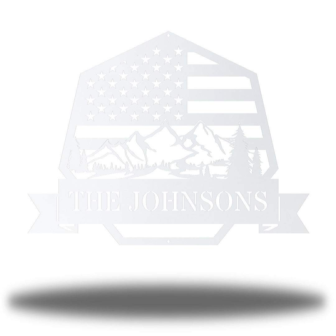 "White heptagonal-shaped US flag wall decor featuring outdoor scenery and the texts ""THE JOHNSONS"""