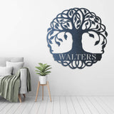 "Black tree monogram with the name ""WALTERS"" on it displayed on the living room"