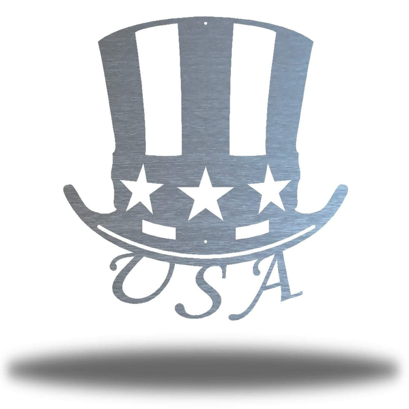 "Silver uncle sam's hat-shaped wall decoration with ""USA"" writing under it"