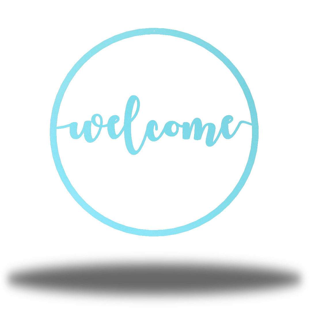 "Light blue steel circle monogram with the word ""welcome"" on it"