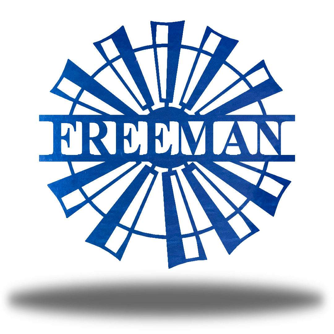 "Blue windmill-shaped monogram with the name ""FREEMAN"" on it"