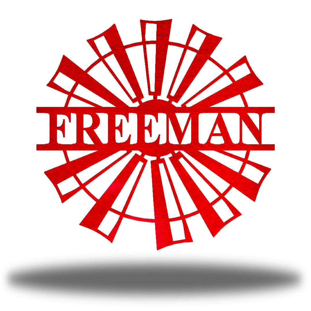 "Red windmill-shaped monogram with the name ""FREEMAN"" on it"