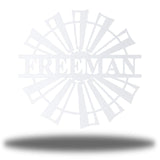 "White windmill-shaped monogram with the name ""FREEMAN"" on it"
