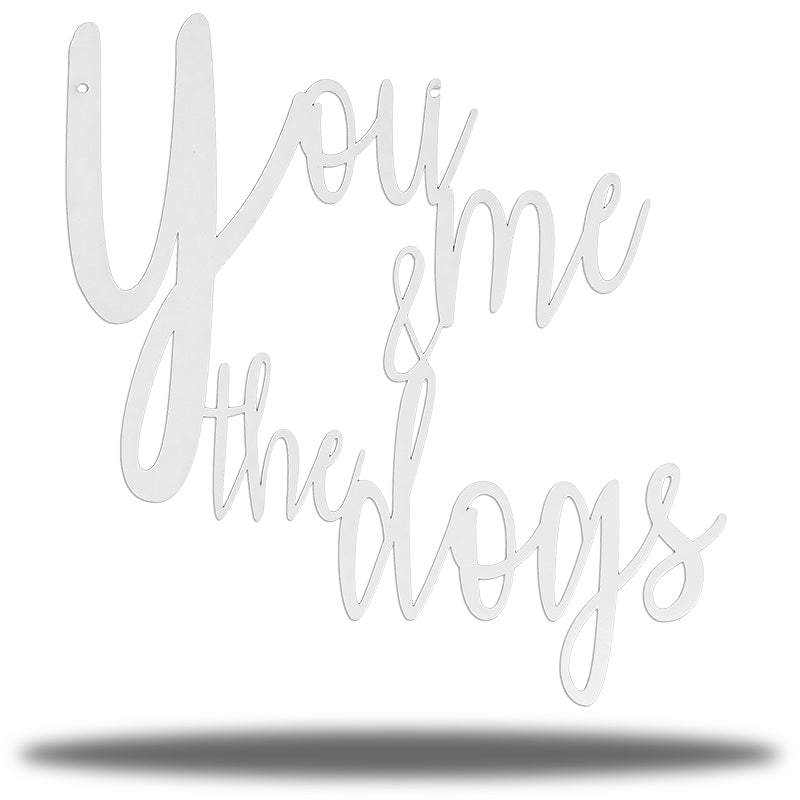 "White typographic wall decoration that says ""You me & the dogs"""""