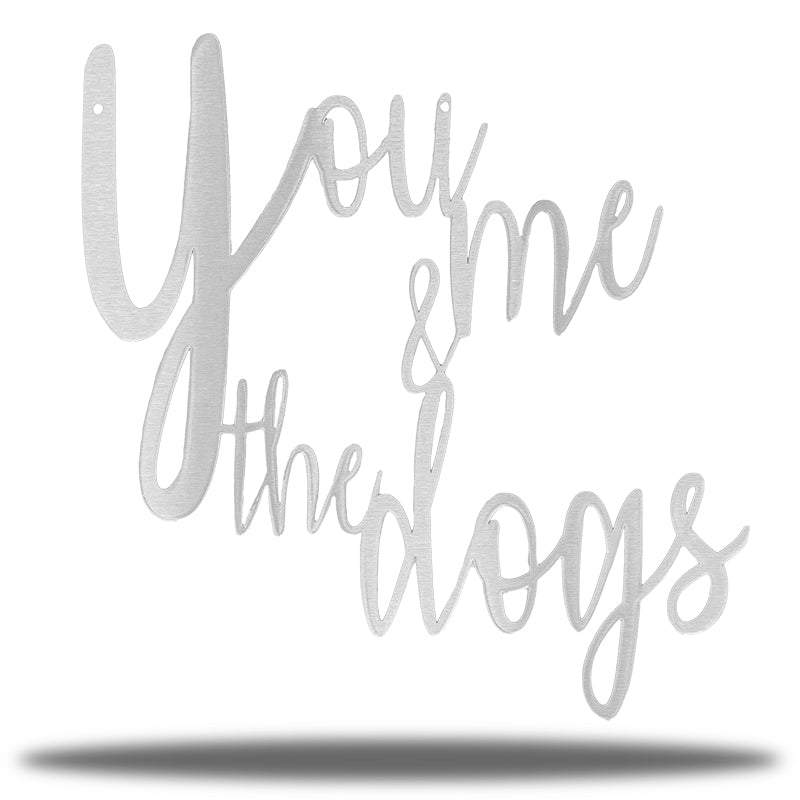 "Silver typographic wall decoration that says ""You me & the dogs"""""