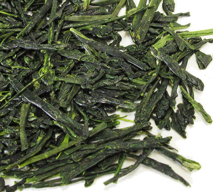 Closeup of dark green whole leaf loose leaf Japanese shincha first-flush 88th Night green tea.