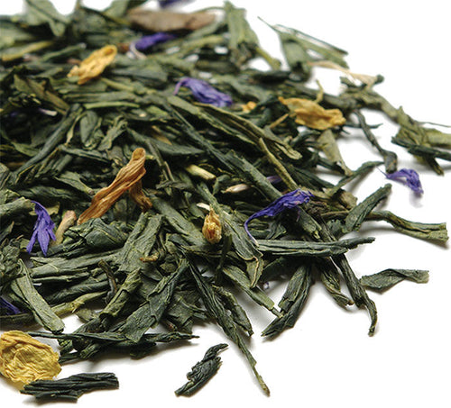 Pile of loose, whole leaf Japanese Sencha and Chinese Dragonwell green tea with blue cornflower and yellow sunflower petals.