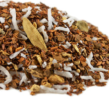 Load image into Gallery viewer, Closeup of mound of herbal blend of loose South African red rooibos, ginger root chucks, cinnamon bark, and coconut flakes.