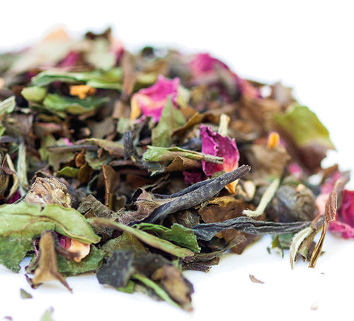 Closeup of Meditative Mind tea blend of whole leaf organic white tea, organic jasmine pearls green tea, organic rose petals.