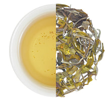 Load image into Gallery viewer, Cup of brewed Natural Glow tea with the loose leaf whole leaf white tea with osmanthus flower petals.