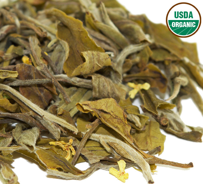 Loose leaf whole leaf Natural Glow white tea with osmanthus flower petals and USDA Organic Certification logo.