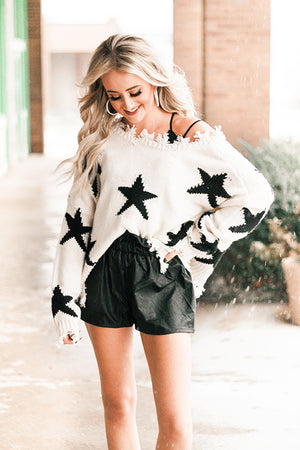 Distressed V-Neck Star Sweater