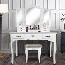 Load image into Gallery viewer, Selection vanity beauty station tri folding necklace hooked mirrors 6 organization 7 drawers makeup dress table with cushioned stool and storage ottoman white