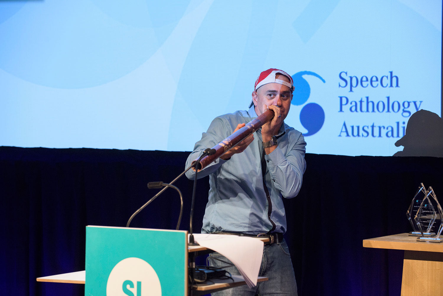 Gregg Dreise breaks out the didgeridoo during the 2015 Speech Pathology Awards