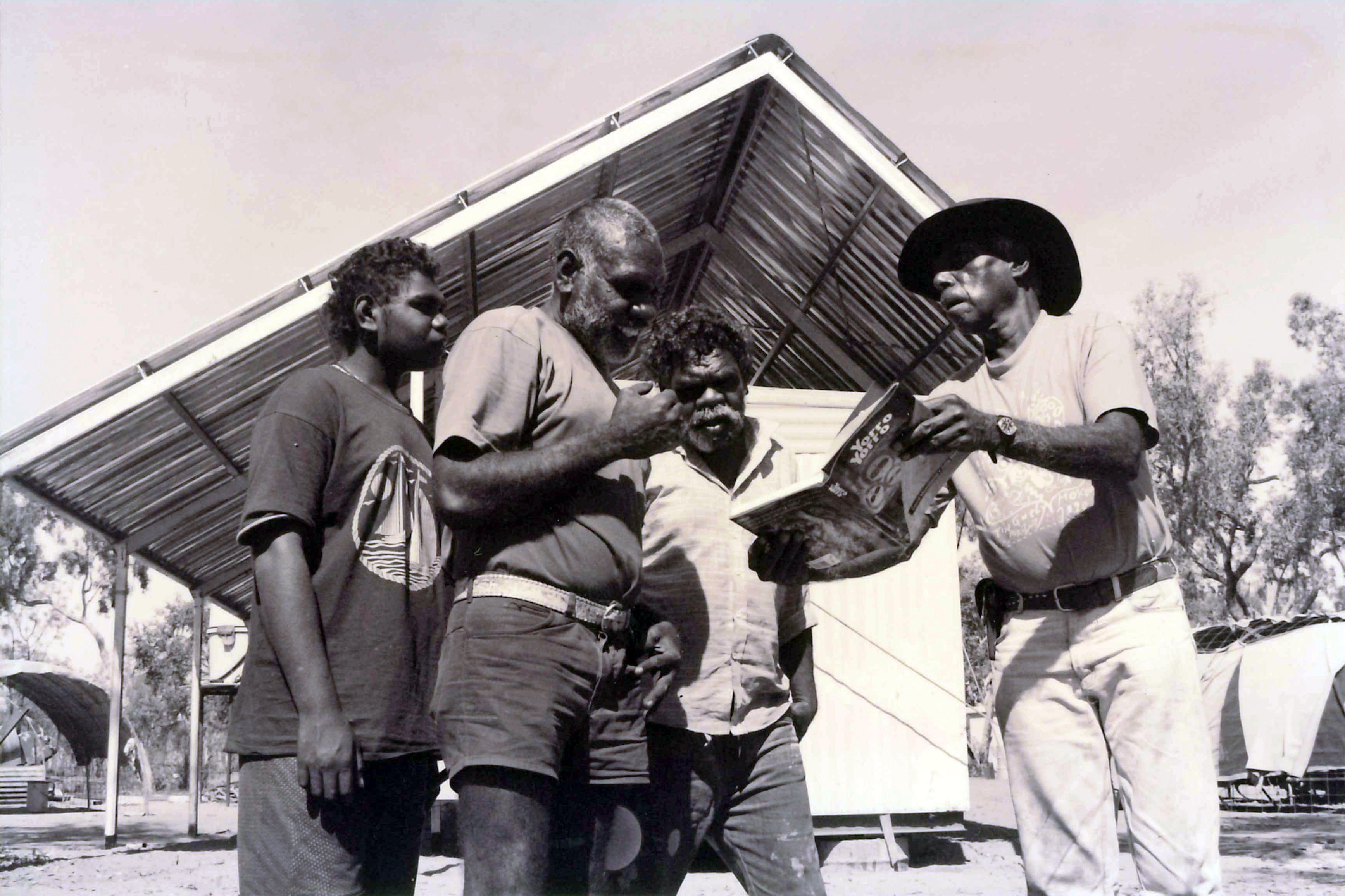 The late David Mowaljarlai (right) showing residents of Kalumburu 'Yorro Yorro', 1993