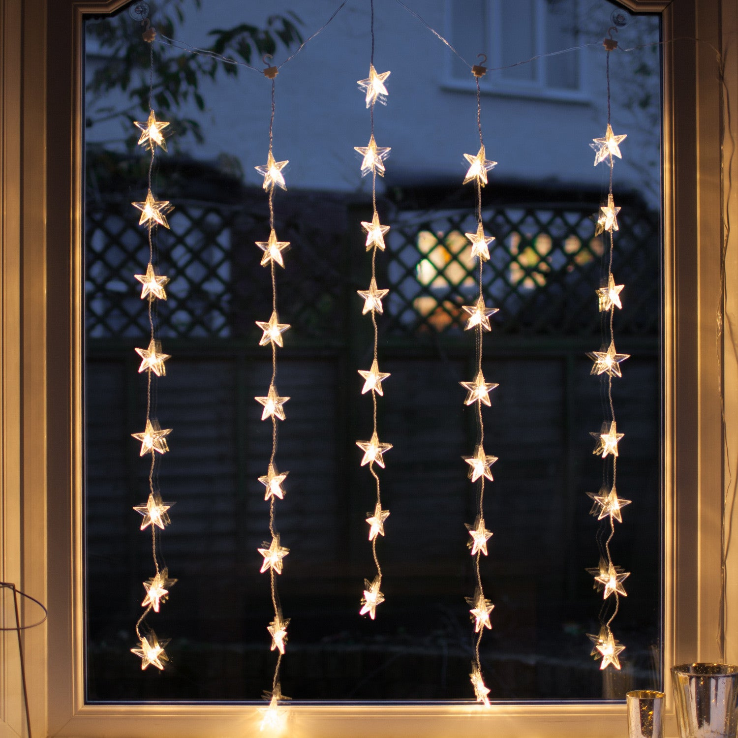 40 Warm White Led Star Curtain Light Lights4fun Co Uk