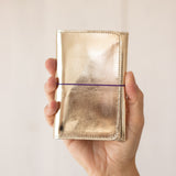 <transcy>Gold metallic leather pocket</transcy>