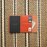 <transcy>Orange vegetable tanned leather pocket</transcy>