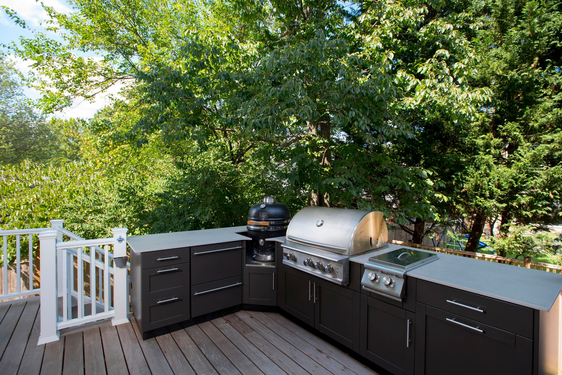 outdoor kitchen 3 with bbq, kamado, and black doors