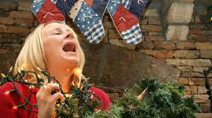 Stock Image of Woman Stressed Surrounded by Holiday Decorations