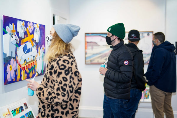 "Art collectors viewing artwork at Voss Gallery's ""Double Vision"" VIP Collectors event in February 2021. Show features work by Tim Irani and Neddie Bakula."