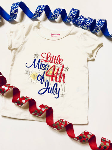 patriotic shirt stitched with red white blue gold and silver thread, reads Little Miss 4th of July Shirt is a white cotton.
