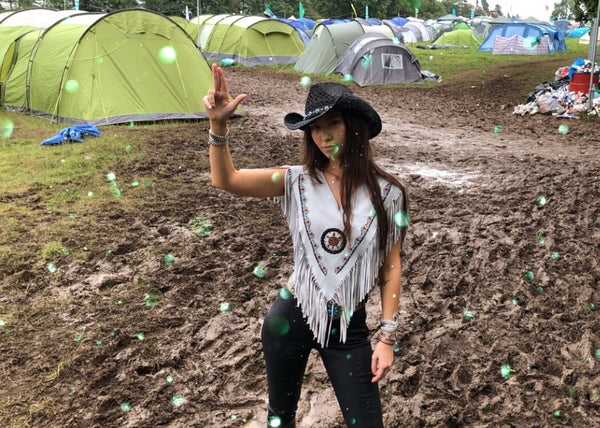 The Wild at Kendal Calling wearing the Hendrix Suede Poncho