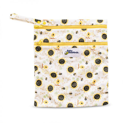 This is the ultimate day out wet/dry bag! Designed with the ability to store new & soiled nappies separately, this is a must have in your collection. The larger pocket will hold 4-5 nappies, & the smaller front pocket 2-3 nappies. Both PUL lined compartments, will keep things dry & smell free.