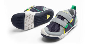 A sturdy sneaker with velcro straps and reinforced rubber toe guard for children and toddlers. For the super active kid. Run, jump, twist, turn, flip, flop, and sing: with either airy, breathable mesh or water resistant ballistic nylon to follow their lead.
