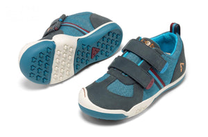 The Plae waterproof children's shoe, with rubber toe guards for durability and grippy soles.