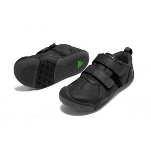 A children's leather sneaker with two velcro straps. All black makes it the perfect sturdy school shoe. This sleek mashup suits the kid who likes to stay on top of their game at all times! Plae Shoes are standard US sizing