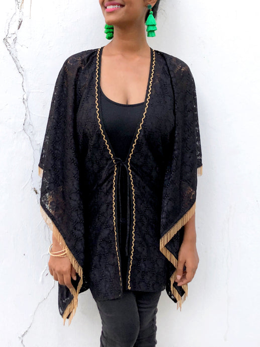 Black lace chiffon beach kaftan cover up with gold trim around neckline and gold fringe on sleeves