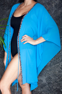 Kaia beach kaftan cover up in azure blue with hand sewn rainbow beaded trim