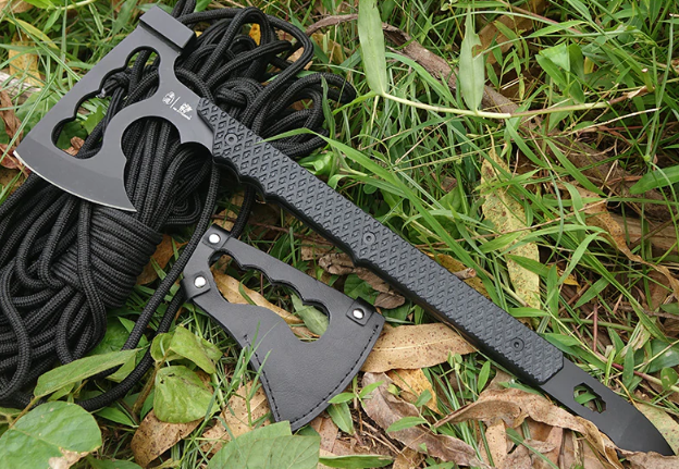LordHawk™ Ultimate Survival Axe layed on grass next to a rope and a sheath