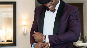 Cam Newton Wearing Custom Meshika Top Hat in Vogue Online
