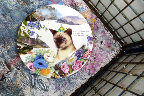 This platter was inspired by the piercing blue eyes of the cat and uses some of the last of these floral transfers.  The cats hat is a hot air balloon and there is a horses arse on the edge so make of that what you will. he who lives without folly large charger with cat Fine bone china gift giftware local mug salvaged vintage print radical Stokes Croft Bristol art bev milward