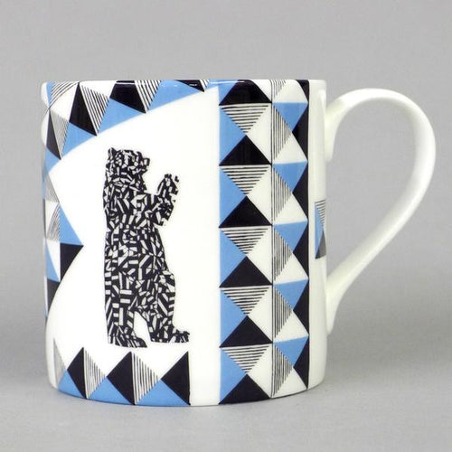 Fine English bone china mug featuring drawing by Jamie Gillman of the Bristol Bear sculpture. From its plinth in the Bearpit in the centre of Bristol, and likeness at the end of the M32 the bear welcomes thousands of visitors into Bristol every day. Combination with the Bristol Scroll makes for a perfect souvenir of this fine city! Fine bone china gift giftware local mug salvaged vintage print radical Stokes Croft Bristol art