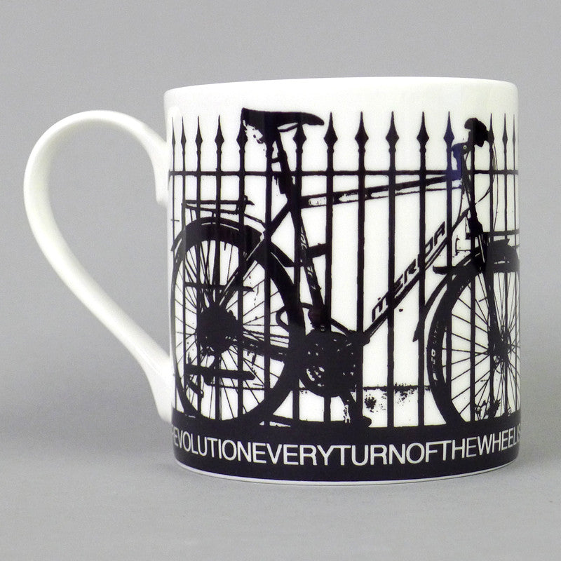 A fine English bone china mug celebrating Bristol's cycling community. These bicycles were photographed outside Bristol Cathedral. Artwork by Flora. Fine bone china gift giftware local mug salvaged vintage print radical Stokes Croft Bristol art souvenir