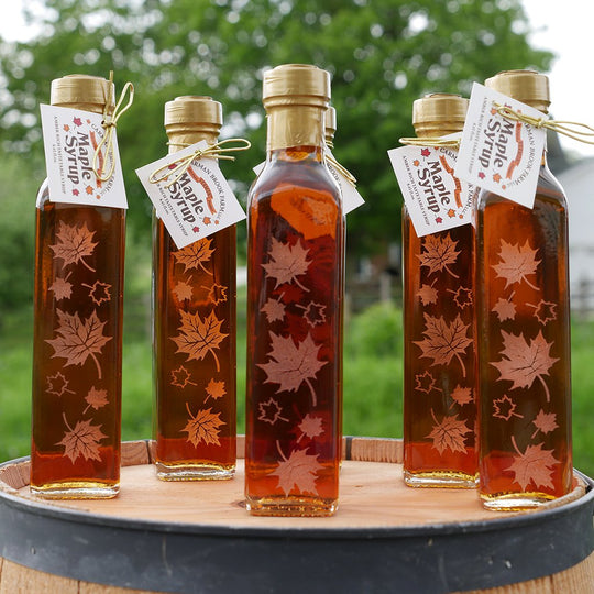 Group of engraved maple syrup client gifts