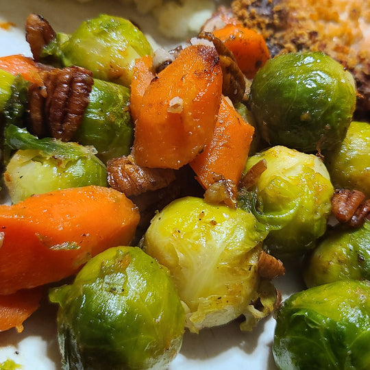 Brussel sprouts and carrots roasted on the stove top with pecans.