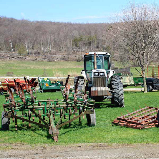 Equipment for sale at the dairy farm auction.