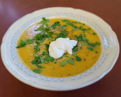 A tasty bowl of butternut squash soup made with maple syrup.