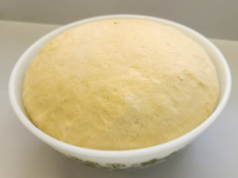 Roll dough that has risen to double in size.