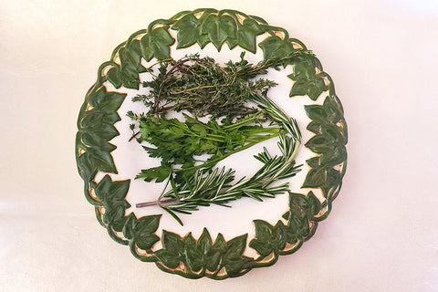 Fresh herbs; thyme, rosemary and parsley, that I will use in a Maple Balsamic Dressing.