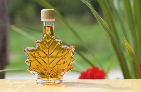 Maple syrup for a wedding favor showing the fine cut of the bottle.
