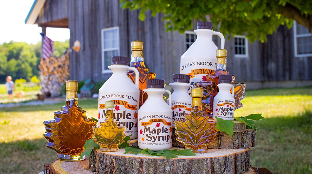 Maple syrup at the Carman Brook Farm is sold in plastic, economical jugs or classy maple leaf shaped glass bottles.