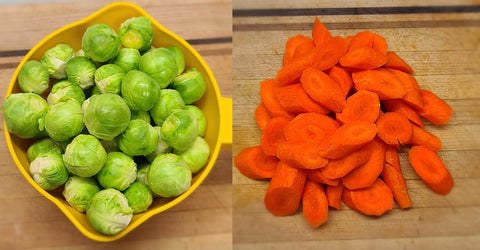 Bright green brussel sprouts and bright orange carrot slices.