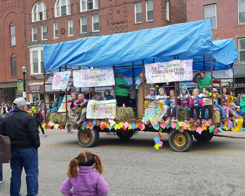 The Girl Scouts on their maple festival parade float.
